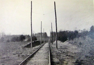 Streetcar tracks 1 mile south of end of line, north of Good Luck Road.